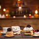 Different cakes with pudding cream on wooden table in a coffee shop - PhotoDune Item for Sale