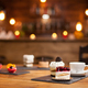 Composition of different cakes with tasty flavours over a wooden table in a coffee shop - PhotoDune Item for Sale