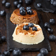 coffee flan and cream pudding with cranberries on black stone tray - PhotoDune Item for Sale