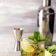 Mojito or Caipirinha cocktail. Brown sugar and an empty glass on stone - PhotoDune Item for Sale