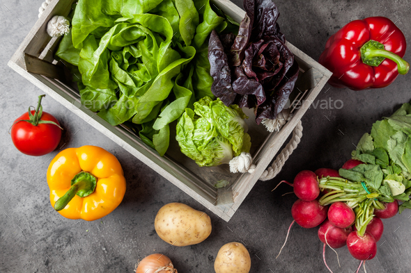 Fresh organic vegetables on rustic background - Stock Photo - Images