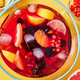 Top view on glass jug with homemade fruit berry drink with ice cubes on yellow background - PhotoDune Item for Sale