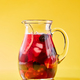 Fruit berry homemade lemonade in a glass jug on a yellow background with copy space. Healthy drink - PhotoDune Item for Sale