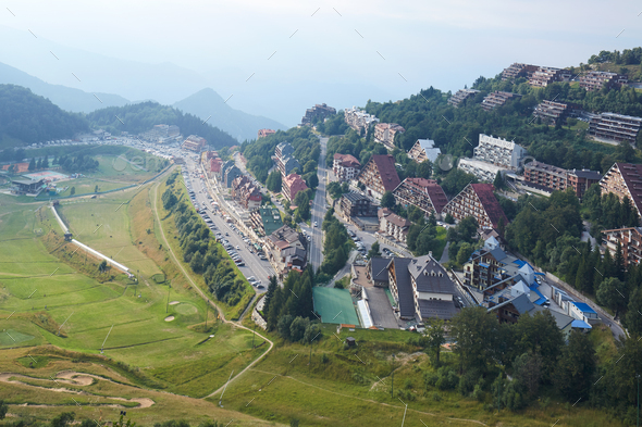 Prato Nevoso town high angle view with mist in a summer day in Prato Nevoso, Italy - Stock Photo - Images