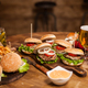 Lots of delicious burgers lying on a table - PhotoDune Item for Sale