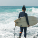 Surfer with surfboard going to surf - PhotoDune Item for Sale