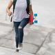 Skateboarder walking with skateboard on city - PhotoDune Item for Sale