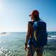 Hiker looking at the beautiful sunrise view at seaside - PhotoDune Item for Sale