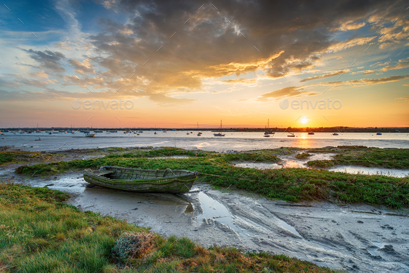 An old boat in the salt marsh at West Mersea - Stock Photo - Images