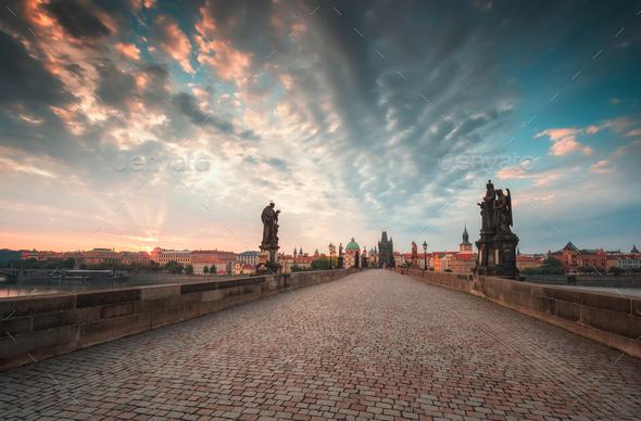 Charles Bridge in Prague at sunrise - Stock Photo - Images
