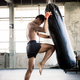 Boxers are training their knees with punching bag - PhotoDune Item for Sale