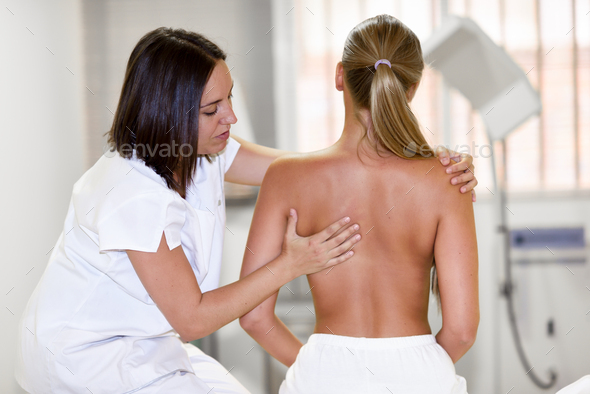Medical check at the shoulder in a physiotherapy center. - Stock Photo - Images