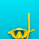yellow diving mask and snorkel over blue background with copy space - PhotoDune Item for Sale
