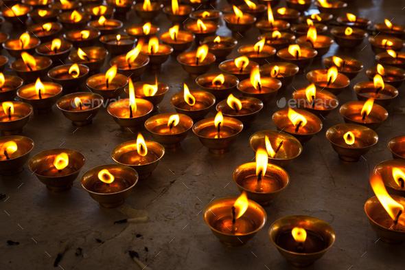Burning candles in Buddhist temple. McLeod Ganj, Himachal Pradesh - Stock Photo - Images
