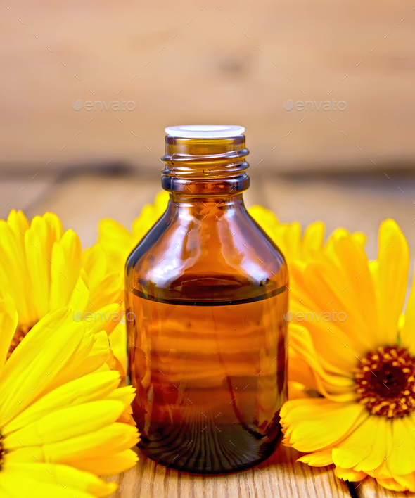 Oil with calendula on board - Stock Photo - Images