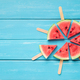 Watermelon popsicles circle on blue wooden background - PhotoDune Item for Sale