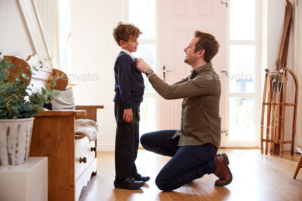 Single Father At Home Getting Son Wearing Uniform Ready For First Day Of School - Stock Photo - Images