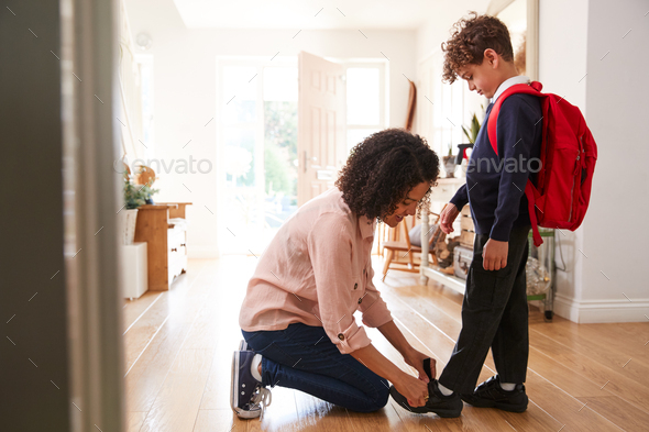 Single Mother At Home Getting Son Wearing Uniform Ready For First Day Of School - Stock Photo - Images