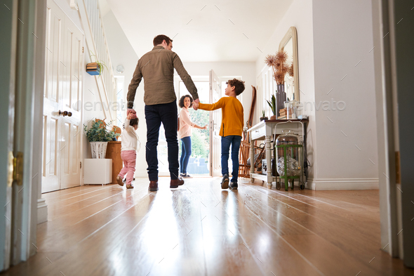 Rear View Of Family Leaving Home On Trip Out With Excited Children - Stock Photo - Images