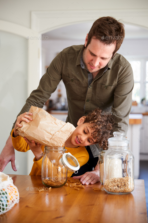 Father Helping Son To Refill Food Containers At Home Using Zero Waste Packaging - Stock Photo - Images