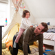 Daughter Riding On Fathers Back As They Play In Den In Bedroom At Home - PhotoDune Item for Sale