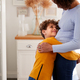 Loving Son Giving Mother Hug Indoors At Home - PhotoDune Item for Sale