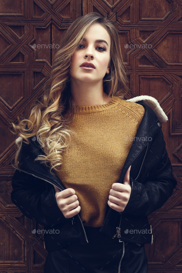 Beautiful blonde russian woman in urban background - Stock Photo - Images