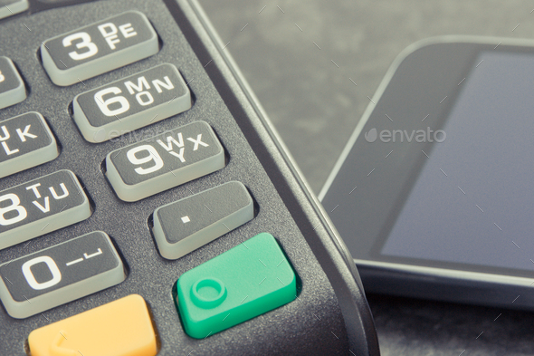 Credit card reader and mobile phone with NFC technology for cashless payment transaction - Stock Photo - Images