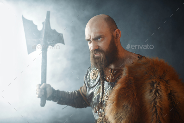 Angry viking with axe, martial spirit, barbarian - Stock Photo - Images