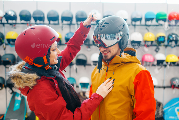 Couple check the strength of the ski helmet - Stock Photo - Images
