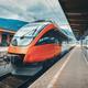 High speed train on the railway station in mountains at sunset - PhotoDune Item for Sale