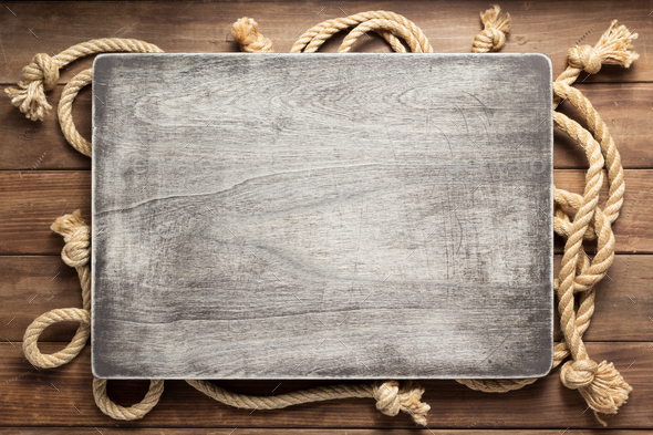 ship rope at wooden background texture - Stock Photo - Images