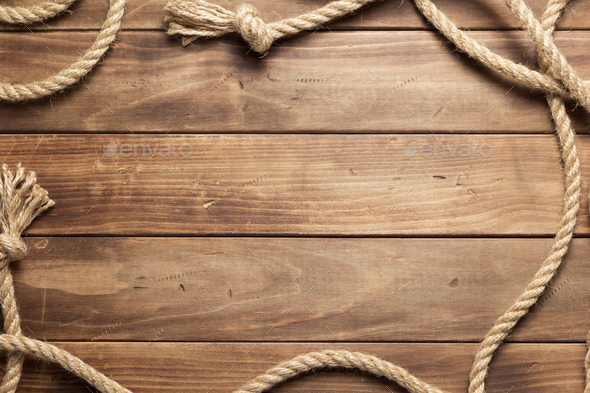 ship rope at wooden board background - Stock Photo - Images