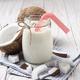 Mason jar of milk or yogurt on blue napkin on white wooden table - PhotoDune Item for Sale