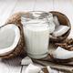 Mason jar of milk or yogurt on hemp napkin on white wooden table - PhotoDune Item for Sale