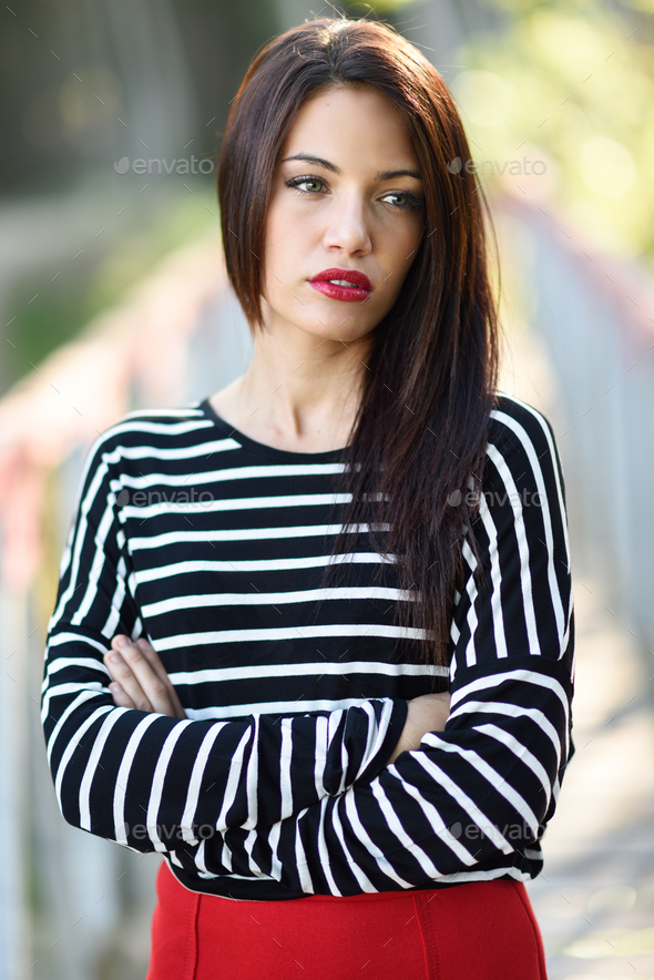 Young woman with green eyes wearing young clothing - Stock Photo - Images