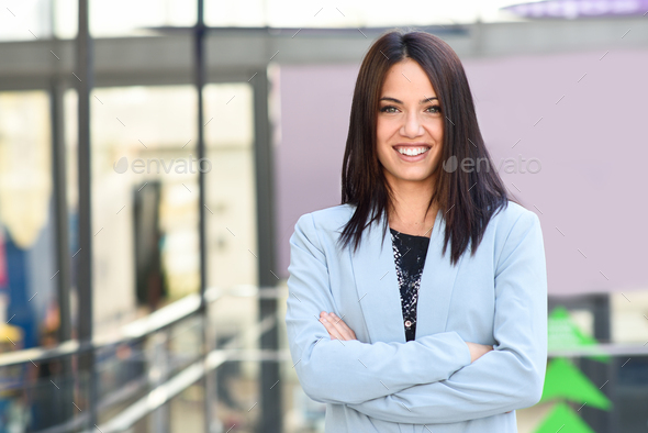 Businesswoman in modern office building - Stock Photo - Images