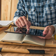 Carpenter using digital tablet to complete project to do list - PhotoDune Item for Sale