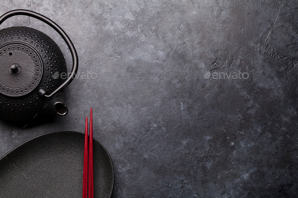 Empty plate, teapot and chopsticks - Stock Photo - Images