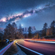 Milky Way over mountain road. Blurred car headlights - PhotoDune Item for Sale