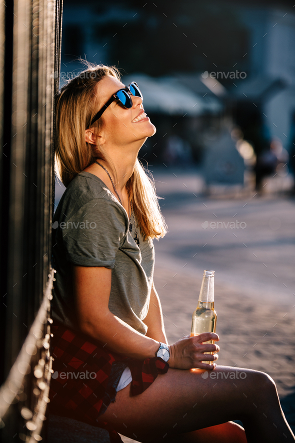 Urban lifestyle, hipster beautiful woman having fun on the street - Stock Photo - Images