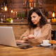 Portrait of smart beautiful woman using laptop for work in a coffee shop - PhotoDune Item for Sale