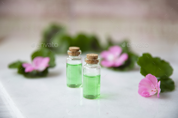 Small Bottles with Plant Extract - Stock Photo - Images