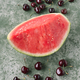 watermelon and cherries on textured green background - PhotoDune Item for Sale