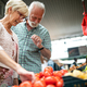 Picture of senior couple at marketplace buying vegetables - PhotoDune Item for Sale