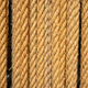 Vertical ropes, tether in row, empty background. Brown twisted cord backdrop. - PhotoDune Item for Sale