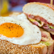 Fried egg sandwich with white bread. Healthy breakfast, Closeup view. - PhotoDune Item for Sale