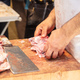 Meat concept. Butcher hands are cutting with cleaver ribs of lamb, sheep. - PhotoDune Item for Sale