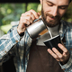 Image of joyous barista man making coffee while working in cafe - PhotoDune Item for Sale