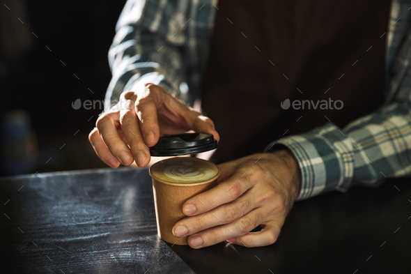 Cropped image of modern barista boy making coffee while working - Stock Photo - Images